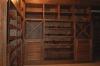 Другой вид стеллажа с решетчатыми фасадами из массива дуба, для сохранения необходимой влажности и температуры